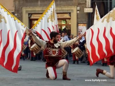 Flag waver Cortona Italy Tuscany